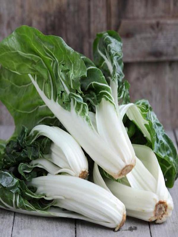 Come verduras de hoja verde para aumentar la función muscular